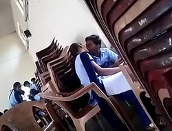 girl and boy giving a kiss in instructor