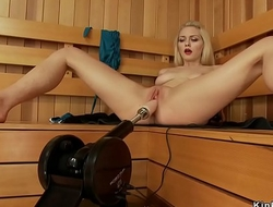 Bald blonde copulates machine in sauna
